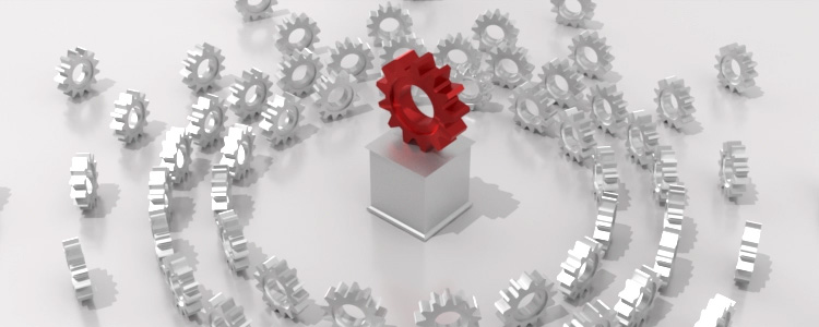 A red gear on a pedestal surrounded by a crowd of gray gears is a metaphor for FabCom's captology or persuasive technology marketing business intelligence.