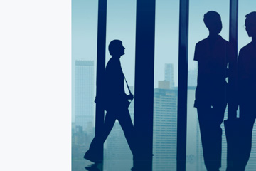 FabCom's website design using anonymous silhouettes of people walking through a healthcare building.