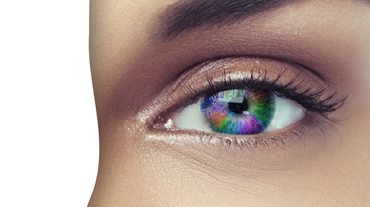 FabCom produced this image with half of a multicultural woman's face obscured and containing the full spectrum of colors superimposed into the iris of her eye.