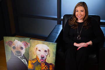 Monique sitting with dog paintings